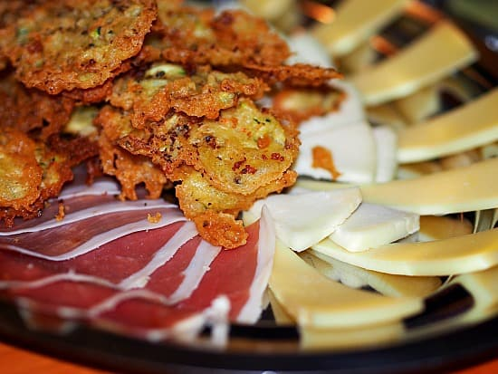 Fried zucchini with Croatian ham and local cheeses. They fried the zucchini with rosemary. I'm definitely stealing this idea! Yum!