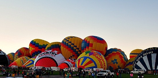 "Just after sunrise and before it warmed up- the ""paid"" ride balloon operator's started to inflate. So cool to see all these balloon's literally on top of each other. You should see the baskets on these balloons. They hold like 20 people! Yikes and no thank you!"