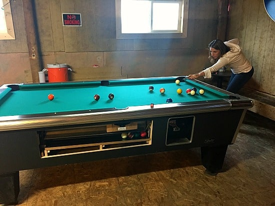 You know that you are at a good dive bar when the room that you are in is all plywood and the pool table has a broken out window so you can play for free!
