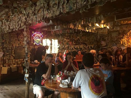 Check out the inside of this saloon! Covered in dollar bills! Thousands and thousands of them! Good retirement plan?