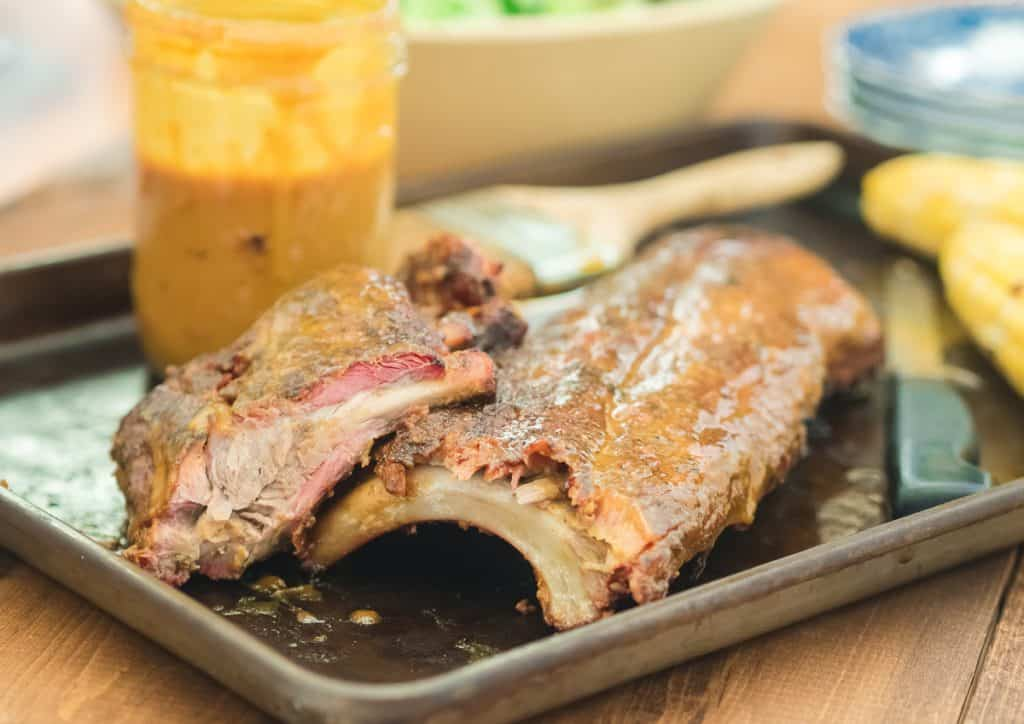 A picture of ribs and Carolina Mustard Sauce