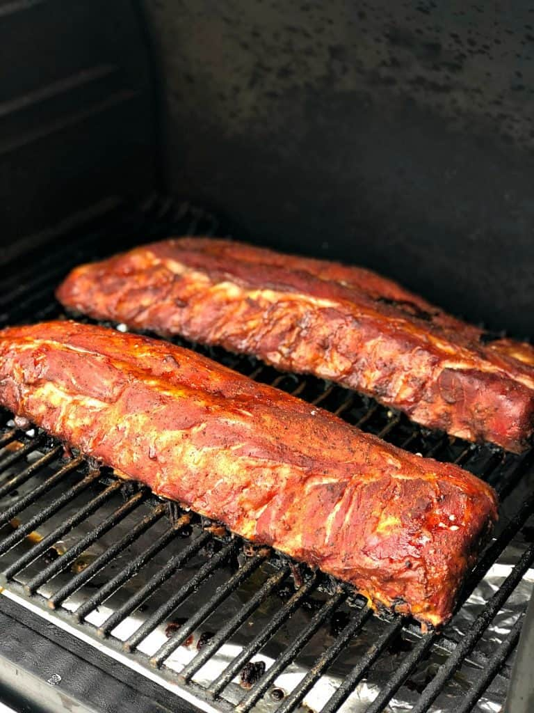 A picture of ribs on the grill after smoking for 3 hours