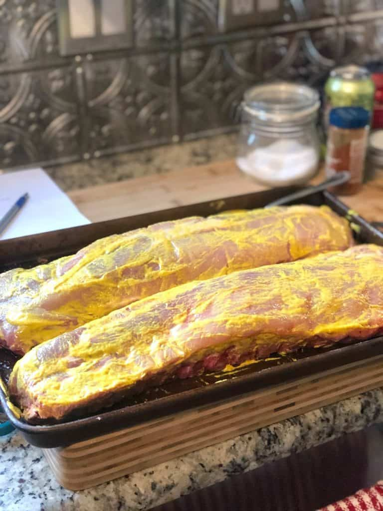 A picture of ribs with mustard