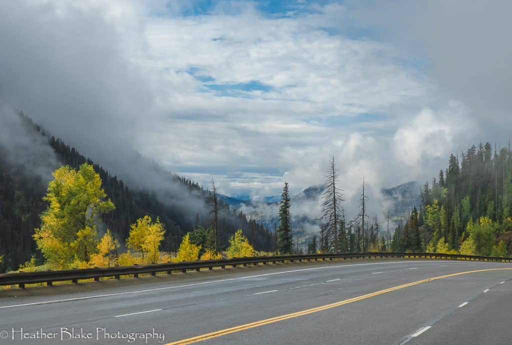 A beautiful view of the mountains and the clouds coming down Wolf Creek Pass in Colorado