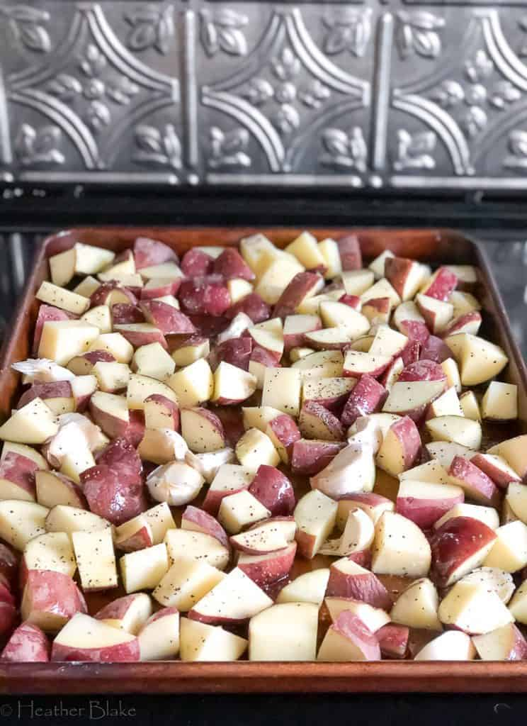 A picture of chopped up potatoes ready to be roasted