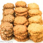 A picture of Anzac Biscuits made three ways. With golden syrup, molasses and corn syrup