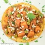 A picture of Mexican Picadillo on top of a tostada.
