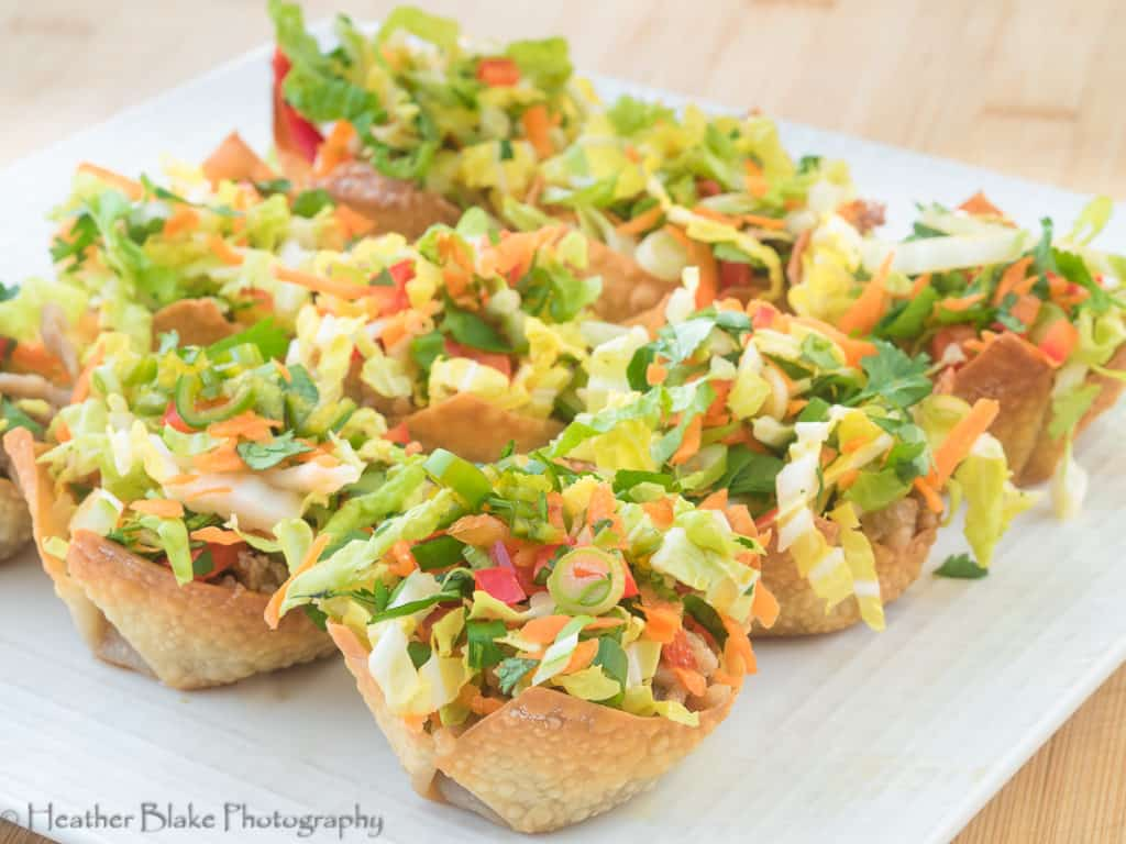 A picture of Bahn Mi Won Ton Cups. It's a beautiful mini salad in a baked won ton skin.