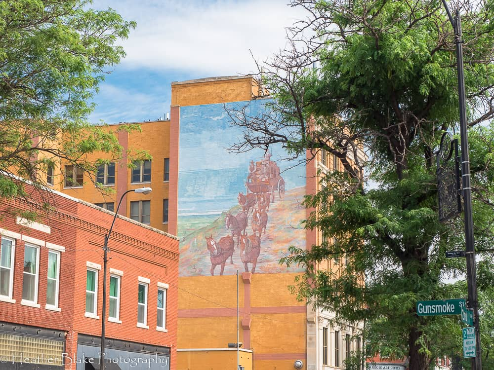 A picture of a stagecoach mural in downtown Dodge City, Kansas.