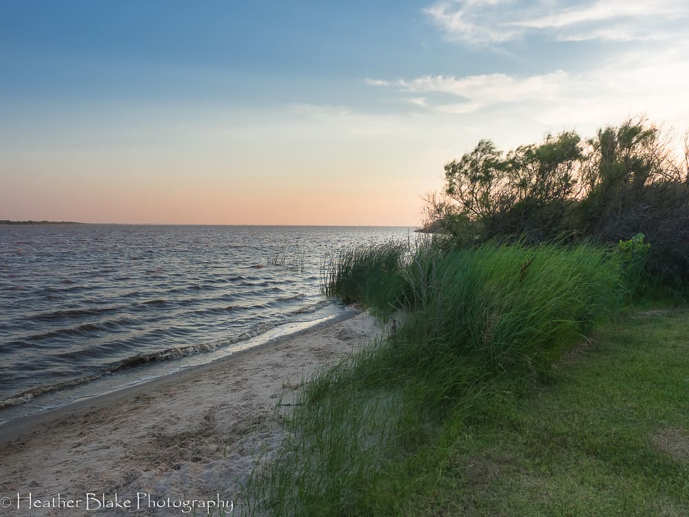 A picture of the lake at Salt Plains State Park in Oklahoma at sunset.
