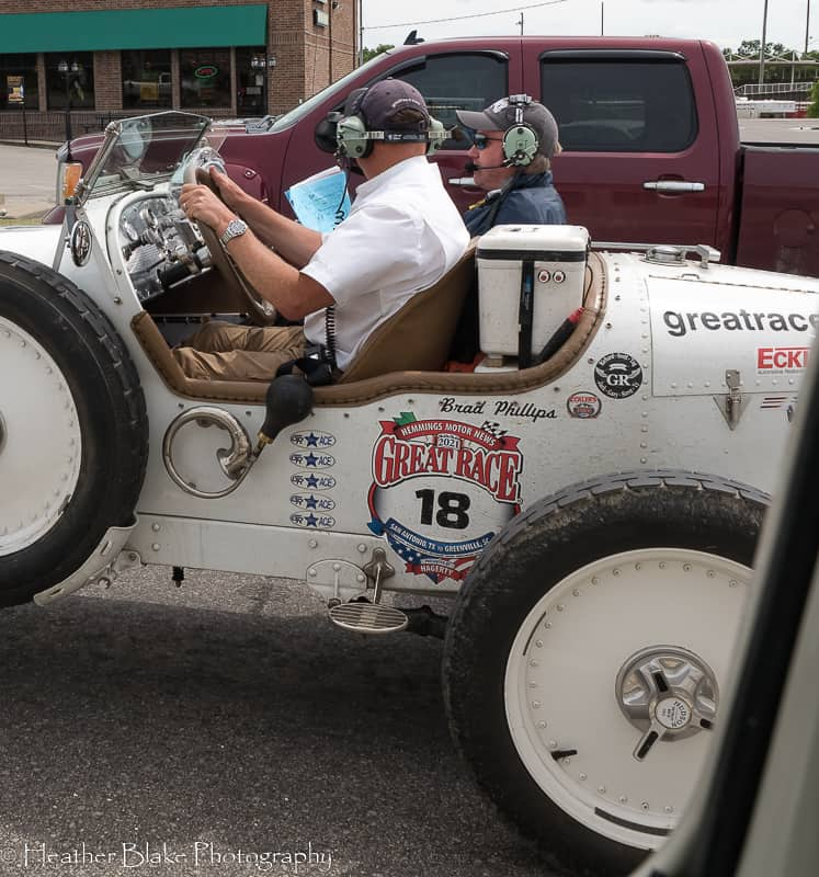 A picture of a race car participating in the Great Race going through Vinita, Oklahoma